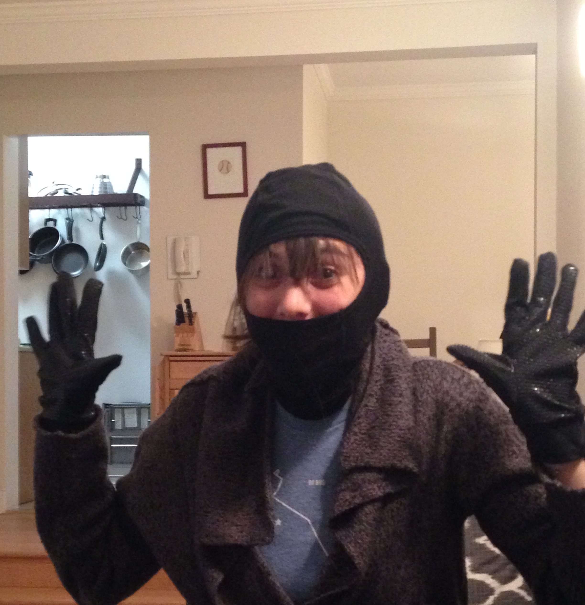 the author sampling some running headgear and gloves