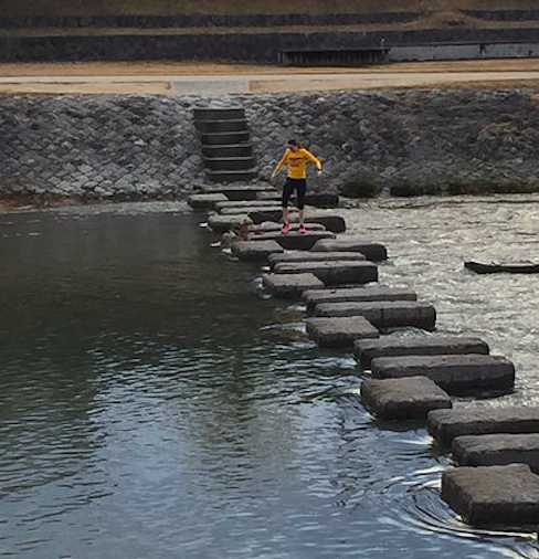 River crossing mid-run in Kyoto